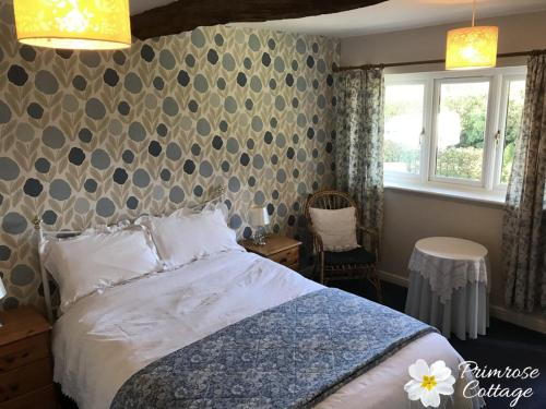 A bed or beds in a room at Primrose Cottage