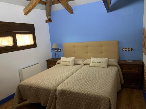 Cama o camas de una habitación en Casa Rural La Tia Lola