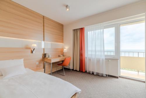 Ein Bett oder Betten in einem Zimmer der Unterkunft Vestina Wellness & SPA Hotel