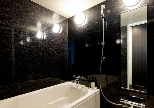 A bathroom at Sonezaki Luxe Hotel