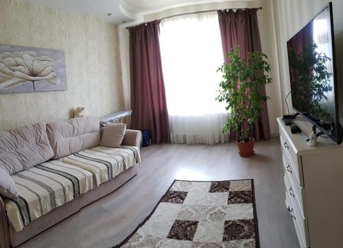 Гостиная зона в Apartment in Swetlogosk