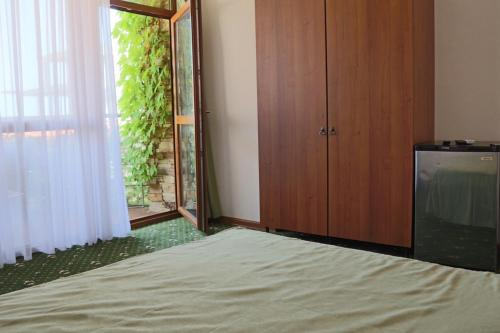 A bed or beds in a room at Villa Beliv Guest House