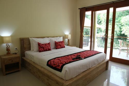 A bed or beds in a room at Gek House Ubud Bali