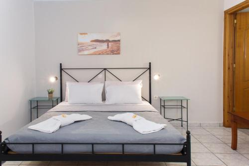 A bed or beds in a room at Avenue Hotel Falassarna
