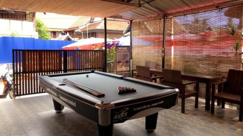 A pool table at DownTown Backpackers Hostel