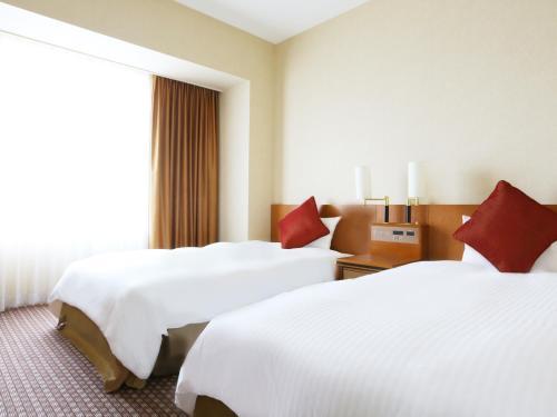 A bed or beds in a room at Star Gate Hotel Kansai Airport