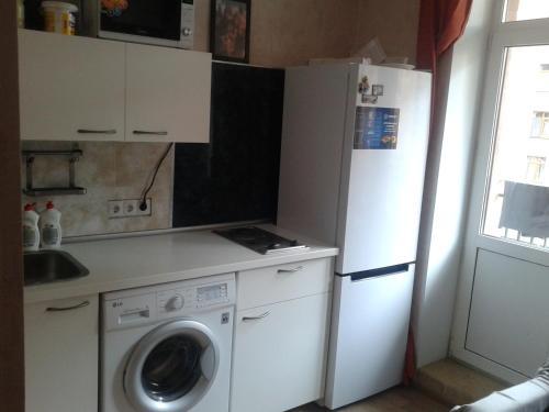 A kitchen or kitchenette at Двухместная комната в квартире