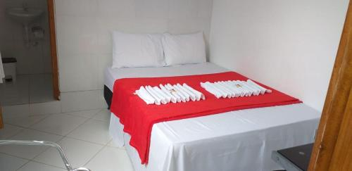 A bed or beds in a room at Pousada Joia do Valle
