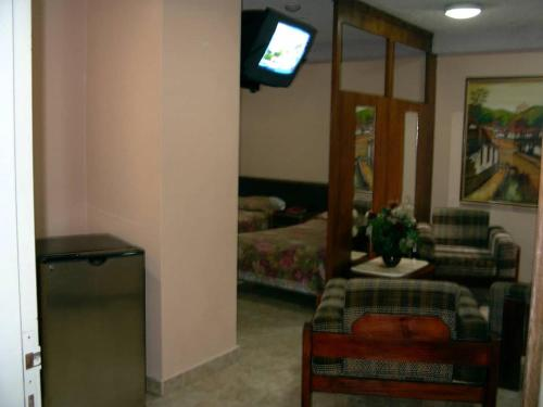 A television and/or entertainment center at Hotel Gran Galaxie