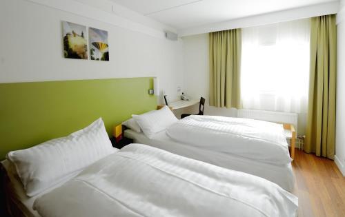 Säng eller sängar i ett rum på Good Morning Lund