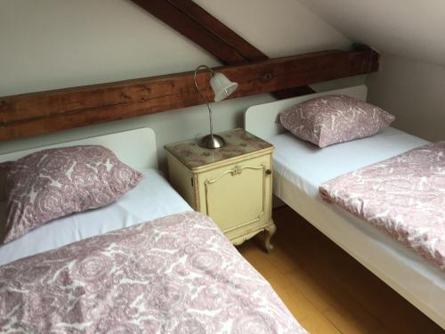 A bed or beds in a room at Hostel Rosemary