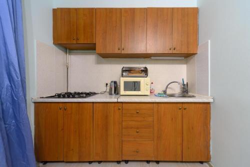 Кухня или мини-кухня в Гостевой Дом Филин