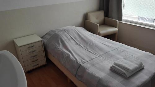 Een bed of bedden in een kamer bij Bed & Breakfast Vlissingen