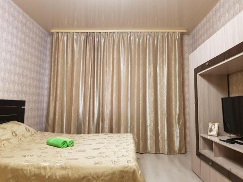 Кровать или кровати в номере Улучшенные апартаменты на Ауре