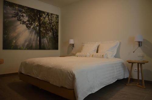 Een bed of bedden in een kamer bij Aquarand