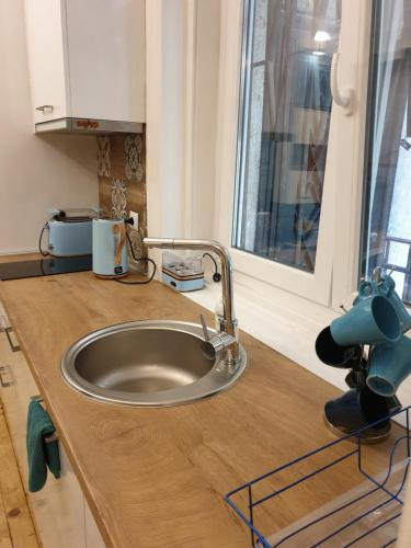 A kitchen or kitchenette at Nice Place