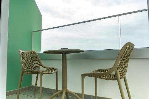 A balcony or terrace at Pefkos City Hotel