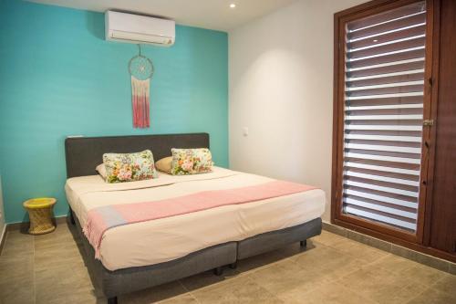 Cama ou camas em um quarto em Boca Gentil villa C3 - Jan Thiel