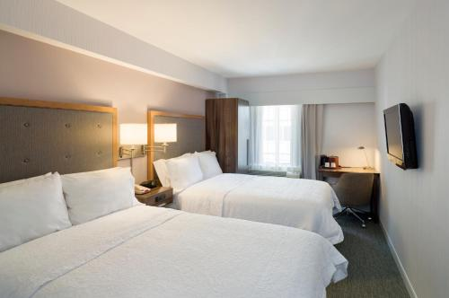 A bed or beds in a room at Hampton Inn Madison Square Garden
