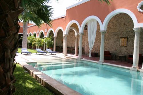 The swimming pool at or near Hotel Hacienda Mérida