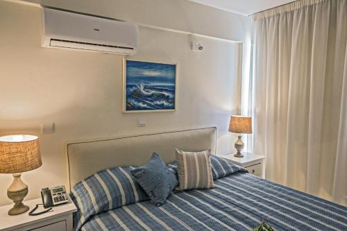 A bed or beds in a room at Napasol Boutique Hotel