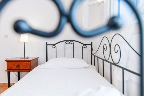 Ένα ή περισσότερα κρεβάτια σε δωμάτιο στο Didymes Studios
