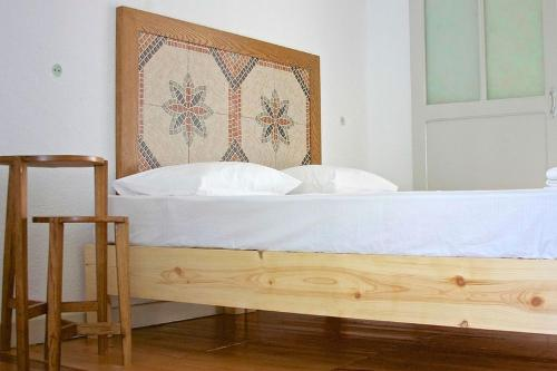 A bed or beds in a room at Himara Hostel