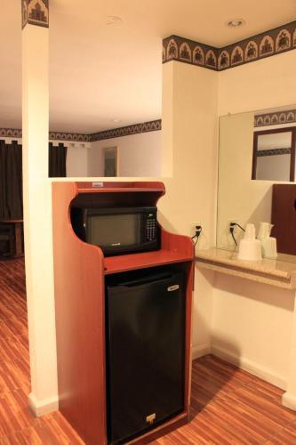 A kitchen or kitchenette at Menifee Inn