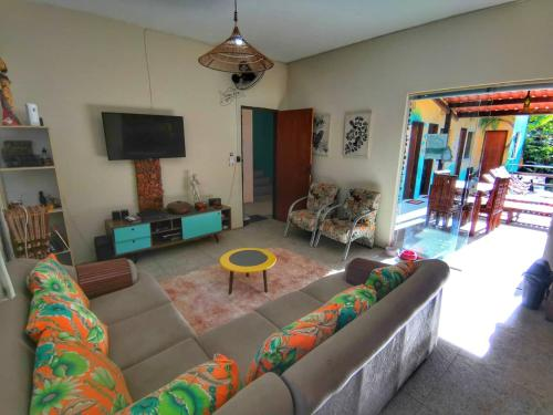 Uma área de estar em Farofa Loca Hostel