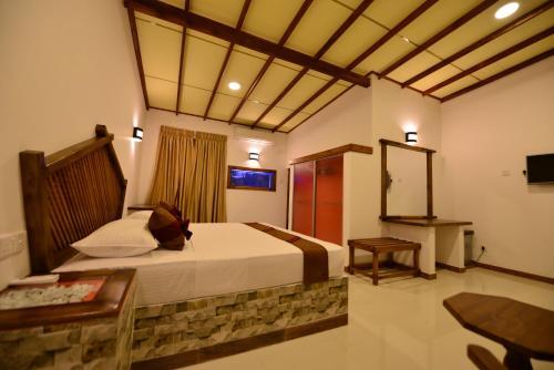En eller flere senge i et værelse på J C Village
