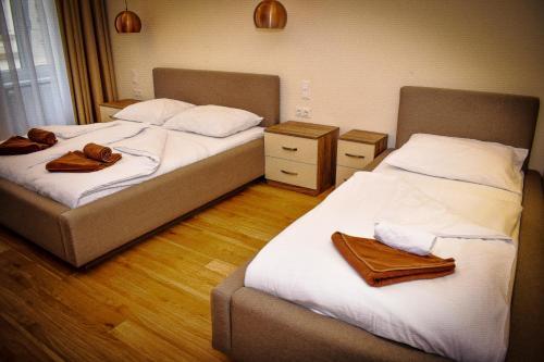 Ein Bett oder Betten in einem Zimmer der Unterkunft Aurellia Apartments