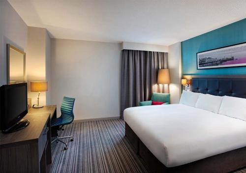 A bed or beds in a room at Jurys Inn Brighton