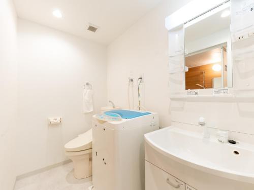 Łazienka w obiekcie Hotel MUSUBI KYOTO Kuramaguchi Omiya