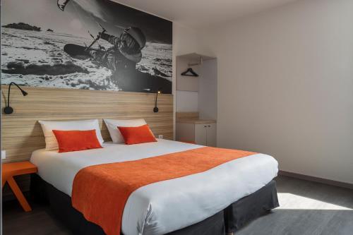 Un ou plusieurs lits dans un hébergement de l'établissement Aka Lodge Lyon Est
