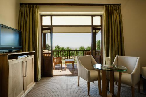 A television and/or entertainment center at Asara Wine Estate & Hotel