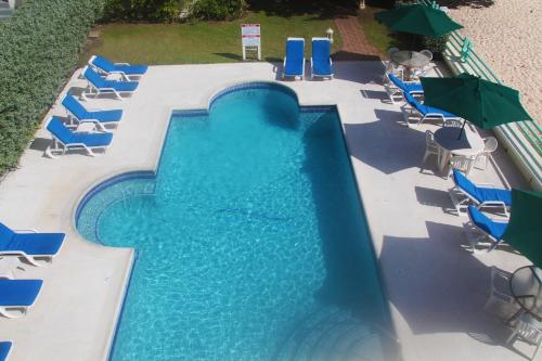 A view of the pool at Coral Mist Beach Hotel or nearby