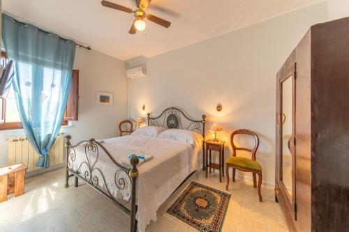 Letto o letti in una camera di Agriturismo Isola Dei Calanchi - Guest House