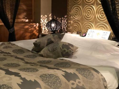 レステイ 水戸(大人専用)にあるベッド