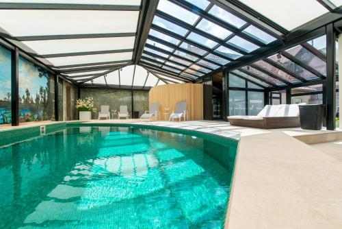 The swimming pool at or near Boutique Hotel Die Swaene