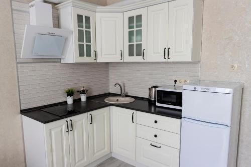 A kitchen or kitchenette at Апартаменты Прованс