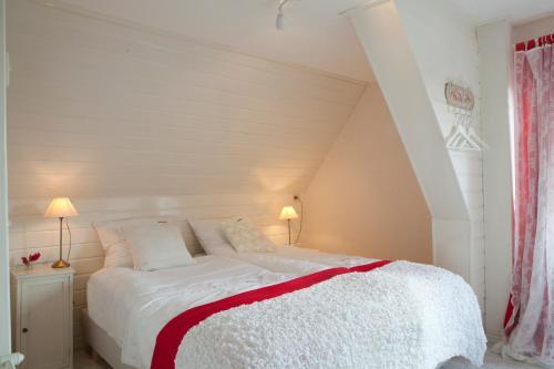 Een bed of bedden in een kamer bij Catherina Hoeve