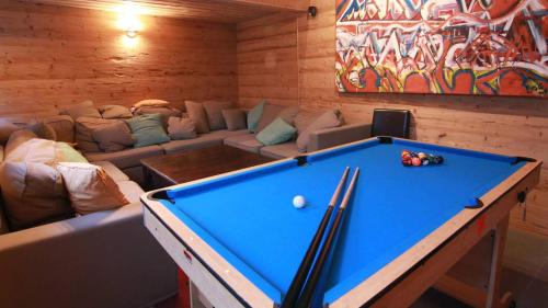 A pool table at Mont Blanc Spa Chalet