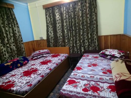A bed or beds in a room at Vamoose Newahang