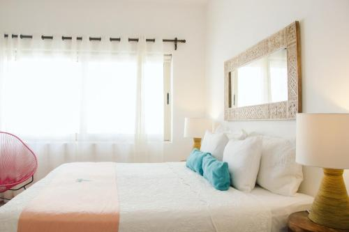 A bed or beds in a room at Condohotel Fabiola