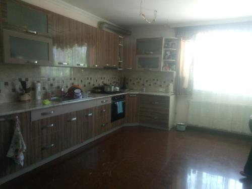 A kitchen or kitchenette at House In Kvareli