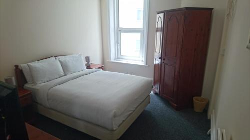 A bed or beds in a room at So Eastbourne