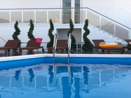 The swimming pool at or near Sea shell hotel