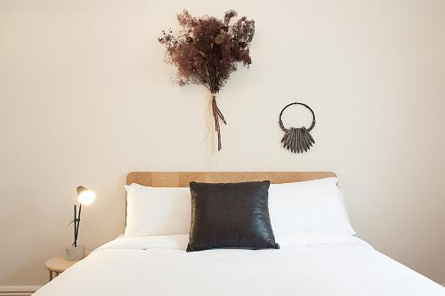 A bed or beds in a room at SONGBIRD VIVENDA - Hosted by L'Abode Accommodation