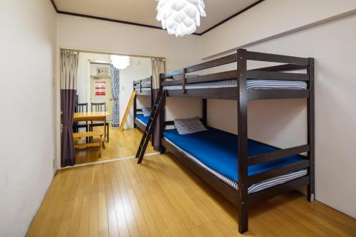 A bunk bed or bunk beds in a room at CPM Center of Shinjuku6
