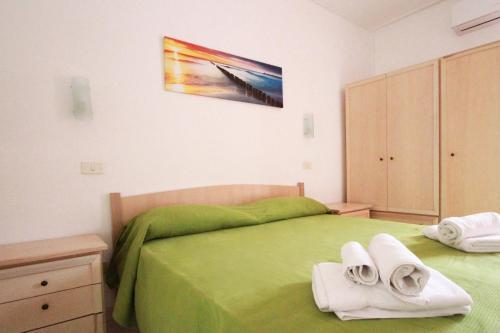Letto o letti in una camera di Residence Calavà
